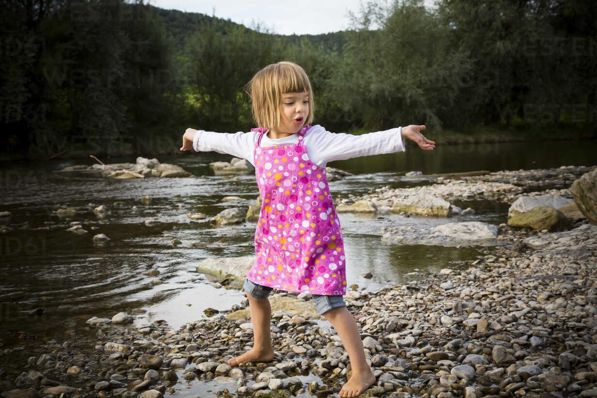 Little girl dancing at riverside - LVF001790 - Larissa Veronesi/Westend61