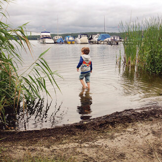 Boy wading in water - AFF000116