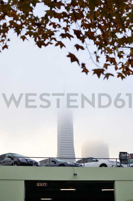 USA, California, San Francisco, Transamerica Pyramid in morning fog behind parking level - BRF000731