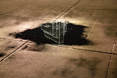 USA, California, San Francisco, reflection of a skyscraper in a puddle at night - BRF000779