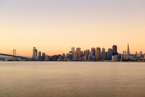 USA, California, San Francisco, Oakland Bay Bridge and skyline of Financial District in morning light - BRF000711