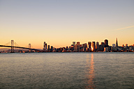 USA, California, San Francisco, Oakland Bay Bridge and skyline of Financial District in morning light - BRF000786