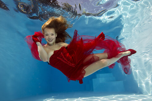 Girl in red dress underwater - YR000051