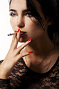Portrait of smoking young woman with red nail polish - JUNF000032