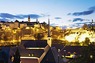 Luxembourg, Luxembourg City, View to the city district Grund and the cloister, Saint Michael's Church in the background, evening light - MSF004255