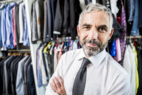 Portrait of businessman at his walk-in closet - MBEF001194