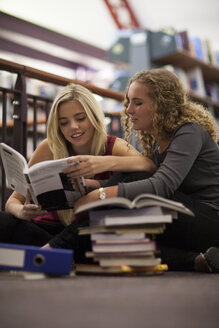 Two female students learning in a library - ZEF000823