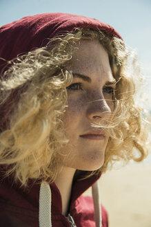 Portrait of teenage girl wearing hooded jacket - UUF001675