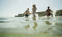 Three teenagers enjoying beachlife - UUF001697