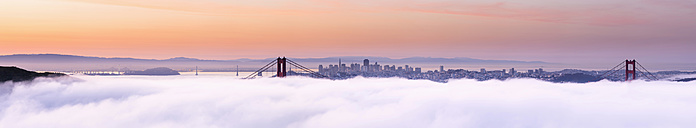 USA, California, San Francisco, skyline and Golden Gate Bridge in fog seen from Hawk Hill - FOF007014
