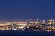 USA, California, San Francisco, skyline and Oakland Bay Bridge at the blue hour seen from Hawk Hill - FOF007074