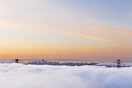 USA, California, San Francisco, skyline and Golden Gate Bridge in fog seen from Hawk Hill - FO007020