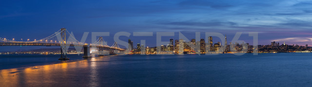 USA, California, San Francisco, Skyline and Oakland Bay Bridge in the evening - FO007060