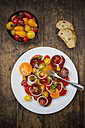 Dish of tomato salad made of different heirloom tomatoes - LVF001860