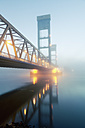 Germany, Hamburg, Bridge with early morning fog - MSF004272