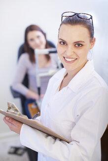 Portrait of smiling eye doctor - ZEF000611