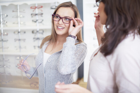 Woman at the optician trying on glasses - ZEF000639