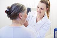 Eye doctor examining senior woman's vision - ZEF000664