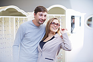 Couple at the optician choosing glasses - ZEF000732