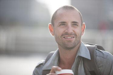 Portrait of smiling businessman - ZEF000216