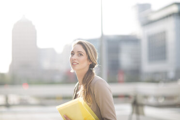 Portrait of businesswoman with file - ZEF000217