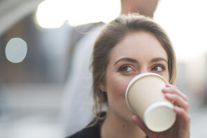 Portrait of businesswoman drinking coffee to go - ZEF000254