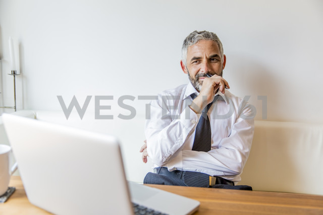 Portrait of businessman at his home office - MBEF001151