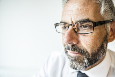 Portrait of serious businessman wearing glasses - MBEF001162