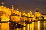 Czech Republic, Prague, Charles Bridge and Old Town Bridge Tower in the evening - WGF000445