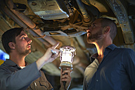 Car mechanic with client in repair garage - ZEF000552