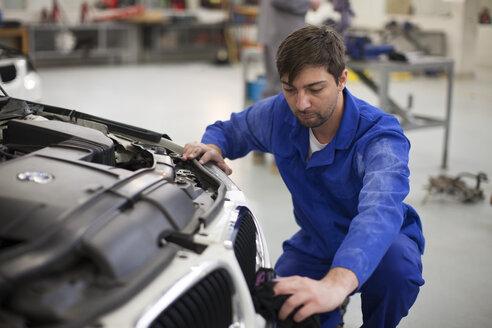 Car mechanic at work in repair garage - ZEF000563