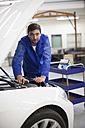 Car mechanic at work in repair garage - ZEF000565