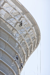 South Africa, Cape Town, three building cleaners working at facade of stadium - ZE000855