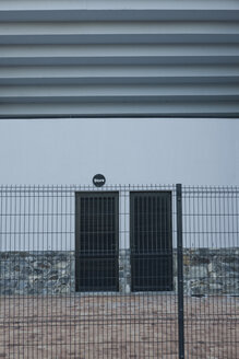 South Africa, Cape Town, two closed doors behind a fence - ZEF000859