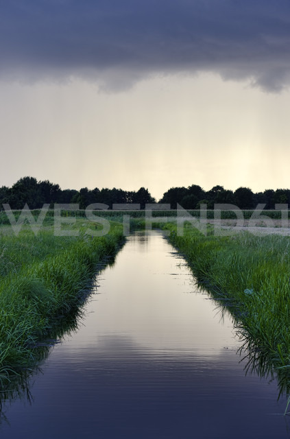 Germany, Hamburg, Drainage canal and rain clouds - GOF000008