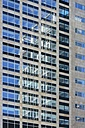 Reflections on facade of high-rise office building, partial view - HAWF000461