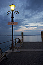 Italy, Veneto, Lazise, harbour, mooring area, street light in the evening - YFF000231