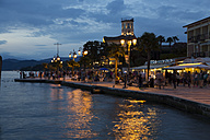 Italy, Lake Garda, Lazise, waterfront promenade at blue hour - SARF000817