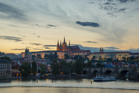 Czech Republic, Prague, Hradcany Castle and St Vitus Cathedral with Vltava River and Charles Bridge at sunset - WGF000455