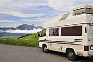 Switzerland, Canton of Bern, Swiss Alps, old caravan on street - SCH000414