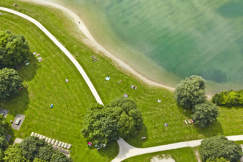 Germany, Bavaria, Feldkirchen, aerial view of people at lakeshore - KDF000022