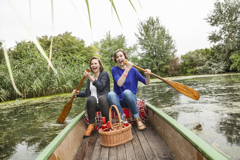 Two playful young woman in rowing boat - DISF001030