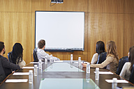 Group of businesspeople looking at empty whiteboard in boardroom - ZEF000265
