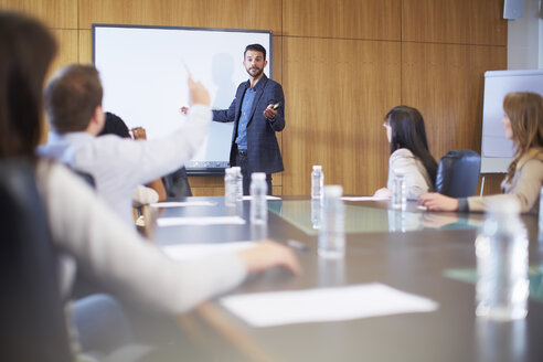 Manager leading business meeting in boardroom - ZEF000268