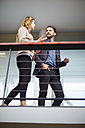 Businessman and businesswoman talking in office - ZEF000278