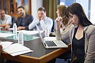Businesswoman using laptop in boardroom - ZEF000293