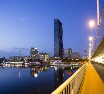 Austria, Vienna, Donau City, DC Tower 1 and Reichsbruecke in the evening - DISF001035