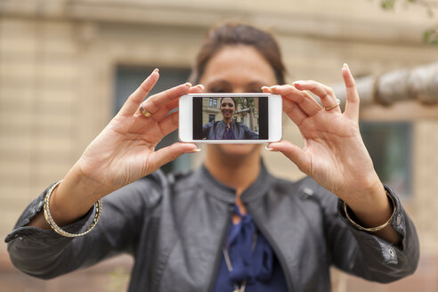 Young woman taking a selfie with smartphone - JUNF000078