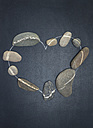 Heart built of pebbles on grey ground - OPF000002