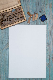 Sheet of white paper, wooden box of wooden letter stamps and an ink pad - OPF000004